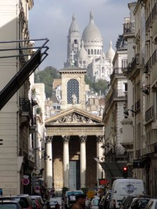 Notre-Dame de Lorette, Paris with Sacre-Coeur in the background.