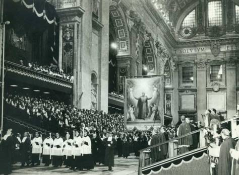 The banner of St Peter Julian Eymard is carried into St Peter's Basilica by members of the Blessed Sacrament Congregation on the day of the canonisation of their founder, 9 December 1962.